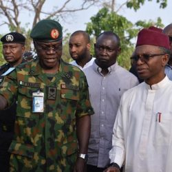 Kaduna State Governor Nasir Elrufai with security operatives during the visit to Kajuru community