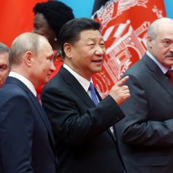 Chinese President Xi Jinping stands between Russian President Vladimir Putin and Belarusian President Alexander at the Shanghai Cooperation Organisation summit in 2018. (Photo by EPA-EFE)