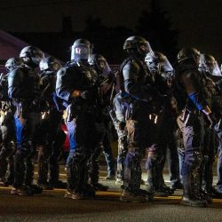 Portland police take control of the streets after making arrests on the scene of the nightly protests at a Portland police precinct on Sunday, Aug. 30, 2020 in Portland, Ore. Oregon State Police will return to Portland to help local authorities after the fatal shooting of a man following clashes between President Donald Trump supporters and counter-protesters that led to an argument between the president and the city's mayor over who was to blame for the violence.(AP Photo/Paula Bronstein)